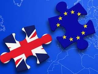 """英国首相暗示""""软脱欧"""" 英镑跳涨至脱欧公投后高位"""