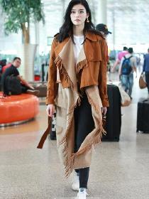 秋冬穿衣搭配技巧示范 一件拼接外套让你与众不同