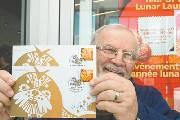 加拿大发售中国狗年生肖邮票 分国际版与国内版两枚